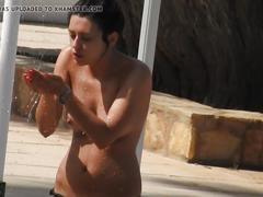 Teen at beach taking topless shower