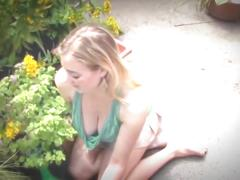Busty blonde in garden