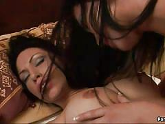 Sexy lesbians share a bed and get intimate