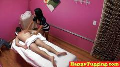 Smalltitted asian masseuse jerks client cock