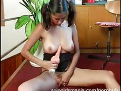 Lovely young brunette masturbating shaved pussy in office