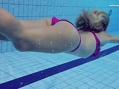 Blonde elena gets naked underwater