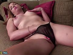 Mature amateur plays with her moist pussy