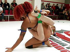 Interracial threesome on the wrestling arena
