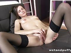 Stocking clad brunette rubs her pussy
