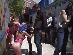 Submissive babes sucking cocks in public