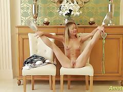 Flexible babe rubs her warm pussy