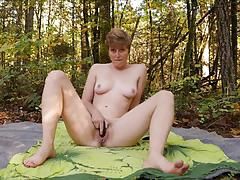 Short haired amateur masturbating outdoors