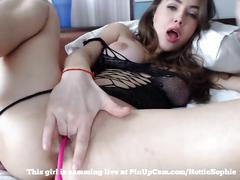Young female fingering her tight pussy on cam