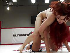 Two redhead fighters on the wrestling arena