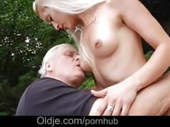 Superb hot blonde seduces white haired old stallion and rides him outdoor