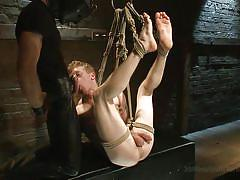 Tied up slave takes a mouthful of dick
