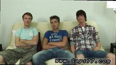 Straight guys wank their hard cocks on sofa together