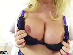 Busty mature toys her pussy