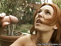 Racy babe tugs on this hard cock