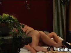 Mistress orgasming hard under slaves golden strapon