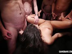 Wild brunette creampied in gangbang