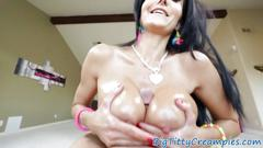 Titfucking milf jizzed on fake tits
