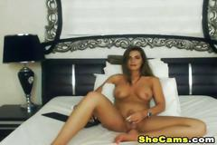 Gorgeous shemale strip and strokes her big cock