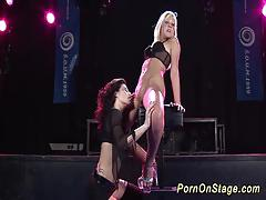 Lesbian babes fuck on stage