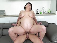 Brunette mature woman sucking on a hard cock