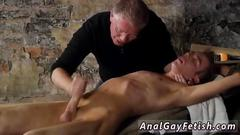 Kinky slave receives a handjob from his mature master