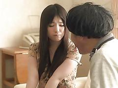 Japanese brunette is stimulated by fingering