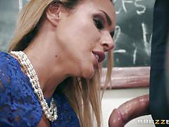 Busty teacher sucks the janitor's cock