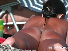Nude babes spied on at the beach