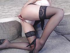 Redhead plays with her warm pussy