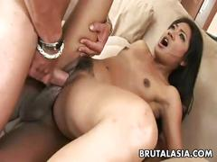 Asian bitch shares two rock hard cocks in a threesome