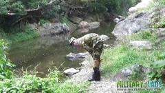 Two military lads resting by the river segment