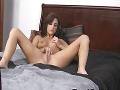 Hot brunette playing her pussy
