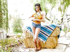 Country gal plays with her pussy by the haystack