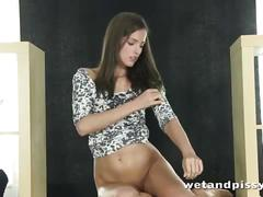 Petite young brunette chick loves to pee