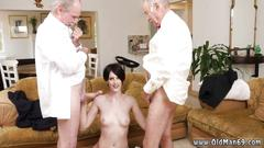 Dark haired bitch sucks two old dicks in this freaky threesome