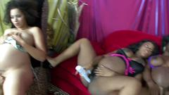Pregnant ebony lesbians masturbate together on the sofa