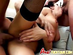 Dark haired babe takes two long cocks in threeway