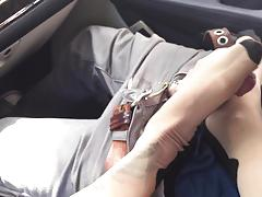 Naughty nadia styles giving a car footjob