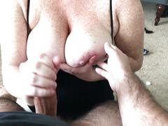 Handjob onto wife's huge freckled tits
