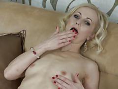 Naughty blonde milf flashes her gash