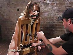 The master punishes this hogtied babe