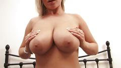 Tall blonde shows her huge bouncy tits to the camera