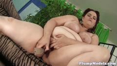 Classy plumper pleasing herself with a dildo