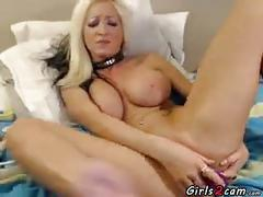 Busty blonde masturbating with a vibrator clip