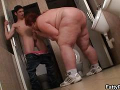 Fatty takes it from behind in the public restroom