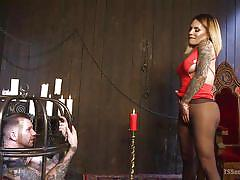 Shemale mistress has her slave in a cage