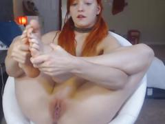 Pretty redhead displays her nice pink pussy