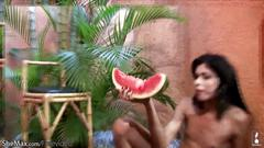 Teen tranny rubs watermelon against her spread ass and jerks