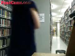 Cute asian slut teasing in library on cam